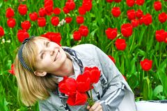 Portrait of girl in tulips Royalty Free Stock Photos