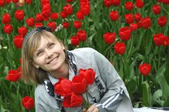 Portrait of girl with tulips Royalty Free Stock Photo