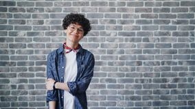 Portrait of girl turning looking at camera with happy smile on brick background. Portrait of joyful girl turning looking at camera with happy smile on brick stock footage