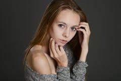 Portrait of a girl in a tweed coat. Portrait of a cute girl in a tweed coat Stock Image