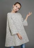 Portrait of a girl in a tweed coat. Portrait of a cyte girl in a tweed coat Royalty Free Stock Photos