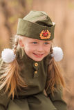Portrait of a girl with two plaits and white bows in uniform on the Victory Day Stock Photo