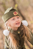Portrait of a girl with two plaits and white bows in uniform on the Victory Day Stock Images