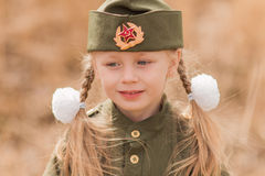 Portrait of a girl with two plaits and white bows in uniform on the Victory Day Royalty Free Stock Images