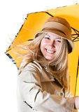 Portrait of a girl with an umbrella. Portrait of a woman in a leather coat with a yellow umbrella Royalty Free Stock Photos