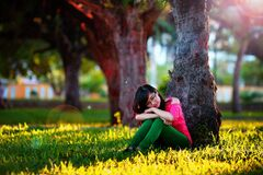 Portrait of girl under tree Royalty Free Stock Photo