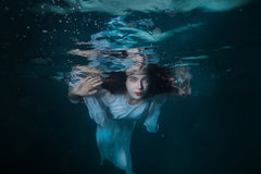 Portrait of the girl under water. Royalty Free Stock Image