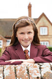 Portrait Of Girl In Uniform Outside School Building Stock Photos