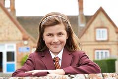 Portrait Of Girl In Uniform Outside School Building Royalty Free Stock Photo
