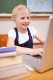 Portrait of a girl using a laptop Royalty Free Stock Image