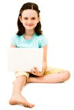 Portrait of girl using a laptop Royalty Free Stock Image