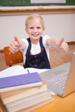 Portrait of a girl using a notebook with the thumbs up Royalty Free Stock Image