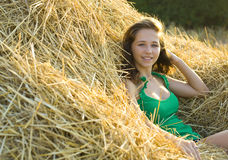 Portrait girl of vacationer on hay Stock Images