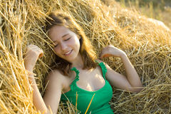 Portrait of the girl of the vacationer on hay Royalty Free Stock Images