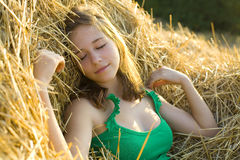 Portrait of the girl of the vacationer on hay Stock Image