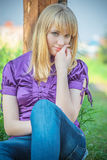 Portrait of girl in violet blouse. Stock Images