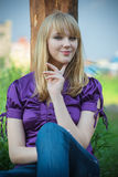 Portrait of girl in violet blouse Stock Photo