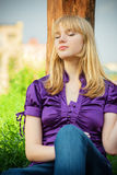 Portrait of girl in violet blouse Stock Photos
