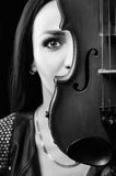 Portrait of a girl with a violin. Black and white photo. Royalty Free Stock Image