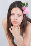 Portrait of girl w flowers in her hair Stock Image