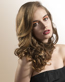 Portrait of girl with wavy hair and folded head Stock Images