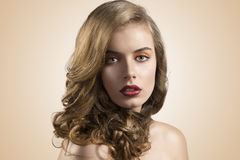 Portrait of girl with wavy hair in front of the Royalty Free Stock Photo