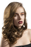 Portrait of girl with wavy hair looks at left Royalty Free Stock Images
