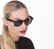 Portrait of a girl wearing fashionable sunglasses Stock Image