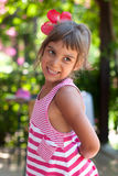 Portrait of a girl wearing flower in her hair Royalty Free Stock Photos