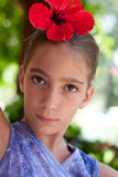 Portrait of a girl wearing flower in her hair Royalty Free Stock Image