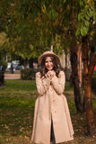 Portrait of a girl wearing  hat and coat in autumn Park Royalty Free Stock Image