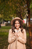 Portrait of a girl wearing  hat and coat in autumn Park Stock Images