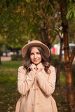 Portrait of a girl wearing  hat and coat in autumn Park Royalty Free Stock Photography