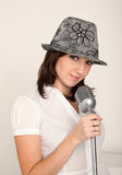 Portrait of girl wearing hat with microphone Stock Photo