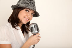 Portrait of girl wearing hat with microphone Stock Image