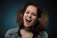 Portrait of the girl wearing headphones Royalty Free Stock Images