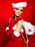 Portrait of a girl wearing santa claus clothes Royalty Free Stock Images
