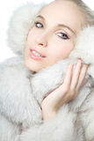 Portrait of girl wearing white fur Stock Photo