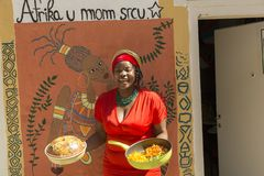 Girl from West Africa. Portrait of the girl from West Africa with food she prepared Royalty Free Stock Photography