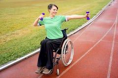 Disabled girl on a stadium Stock Photos
