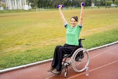 Disabled girl on a stadium. A portrait of a girl in a wheelchair on a stadium Royalty Free Stock Images