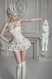 Portrait of a girl in a whight costume. Holding a white bunny Stock Image