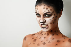 Portrait of a girl on a white background. . face art. body art. hairstyle. black hair. wild cat. growl. snarl. Drawing on the body. female emotions. creative Royalty Free Stock Photography