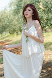 Portrait of a girl with white dress in the olive grove Royalty Free Stock Photography