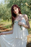 Portrait of a girl with white dress in the olive grove Stock Photography
