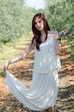 Portrait of a girl with white dress in the olive grove Stock Image