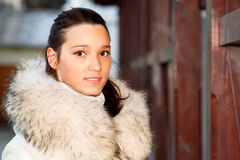 Portrait of girl in white fur coat Royalty Free Stock Photo