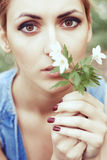 Portrait of girl with white spring flowers Stock Photo