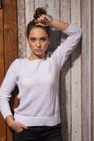 Portrait of a girl in a white sweater Royalty Free Stock Photo