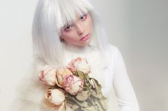 Portrait of a girl in a white wig. Fabulous image royalty free stock images